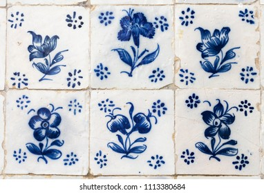 Ornamental old typical tiles from Portugal called azulejos made with colored ceramic tiles