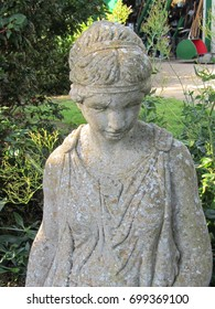 Ornamental stone statue of a classical lady