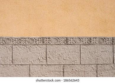 Ornamental wall cladding using granite bricks with floral motives
