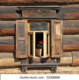 Ornamental window of the old rural house with flower. Suzdal, Gold Ring, Russia.