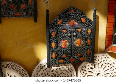 Ornamental wood and metal plaque in the medina of Fes, Morocco, Africa