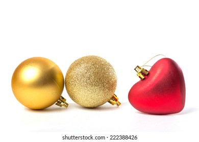 ornaments for the Christmas tree, golden balls of different textures and a red heart