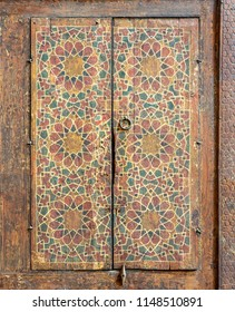 Ornaments of a wooden cupboard painted with colored geometrical patterns embedded in the walls of Sultan al Ghuri Mausoleum, Cairo, Egypt