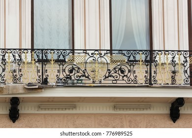 An ornate balcony fence. Excursion - tourist spots in St. Petersburg.
