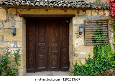 Ornate carved wood doorway in the Fall at ancient hillside village of Yesilyurt, Malatya, Turkey - November 11, 2012