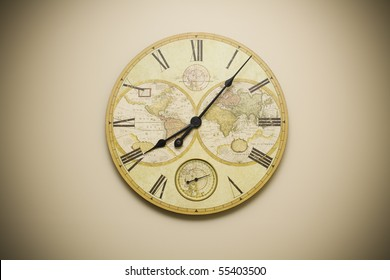 Ornate clock with map of world on it