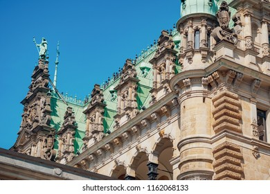 Ornate decorated roof of Rathaus on the blue sky background. Rathaus is the famous Hamburg City Hall, Germany.