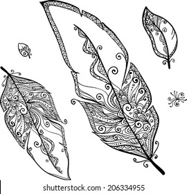 Ornate doodle black and white ethnic feathers set