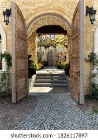 Ornate doorway in Malta, beautiful stonework and plants