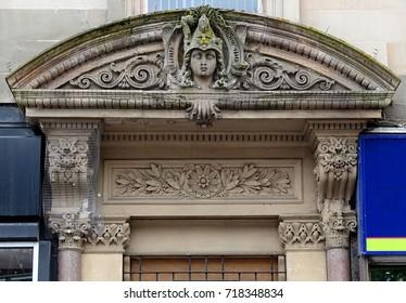 Ornate doorway with mercury keystone