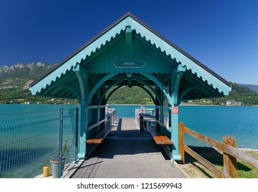 Ornate entrance hut to a wooden jetty on Lake Annecy France