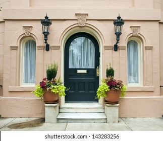 The ornate features of an entrance to a historical pink house, built in the late seventeen hundreds, in Charleston, South Carolina.