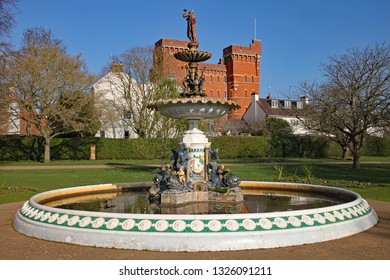 The ornate fountain in Vivary Park, Taunton on a beautiful spring day. Jellalabad barracks is in the background.