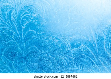 Ornate frost pattern on frosted window as Christmas background