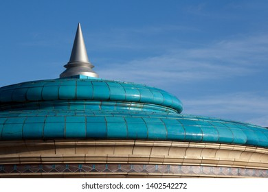 Ornate glazed ceramic tiled roof and metal spire on Eastbourne Bandstand, Eastbourne, East Sussex, England, UK