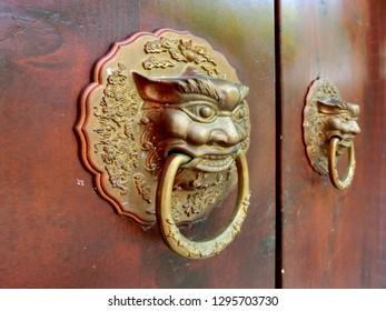 Ornate golden Chinese entrance door knocker