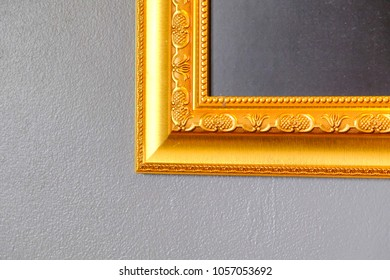 2d2a1513f66 Ornate golden frame at the concrete wall with clipping path for the inside.Black  and