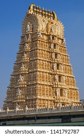 The ornate Gopuram, or gateway, to the Shri Chanundeshwari temple at Mysore. Honoring the Hindu god Durga it can be reached by climbing 1,000 steps. It  has 7 golden Kalahasa on top to denote 7 levels
