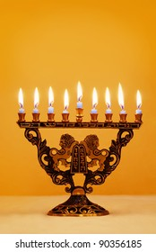 Ornate Hanukkah menorah with lions holding the Ten Commandments