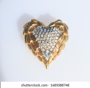 Ornate heart gold tone silver tone in middle rhinestones pave brooch