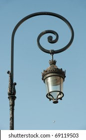 Ornate, old-fashioned Paris streetlight.