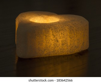 Ornate rock salt tealight candle holder isolated on a black background