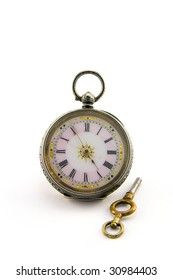 Ornate silver antique watch with key on a white background