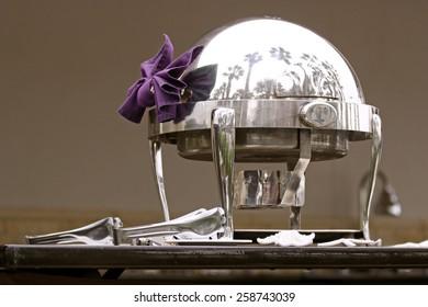 Ornate silver server at a classy breakfast bar