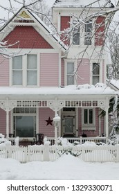 An ornate Victorian home in the snow.