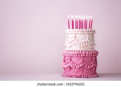 Ornate vintage buttercream birthday cake with buttercream ruffles and frills - Shutterstock ID 1923794255