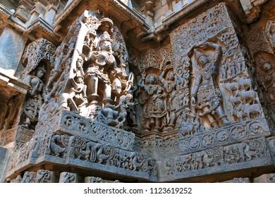 Ornate wall panel reliefs depicting Goddess Kali on the left and Govardhan Girdhari on the right, Hoysaleshwara temple, Halebidu, Karnataka
