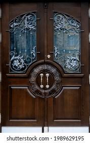 Ornate wooden door with metal ornament