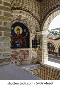 Ornated bricklaying wall with Our Lady icon. St. Ephrem the Syrian monastery, Kondariotissa, Pieria, Greece.