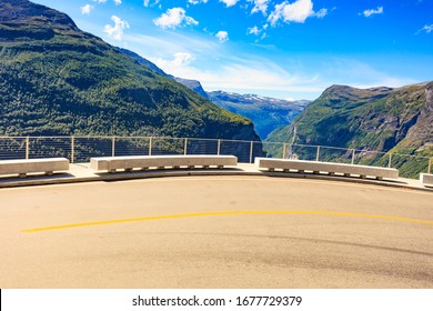 Ornesvingen view point with lookout seat. Geiranger fjord landscape. National Tourist Route in Norway