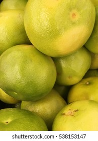oroblanco background. pomelit harvest. green pomelo texture.