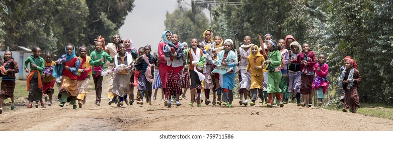 OROMIA, ETHIOPIA-SEPTEMBER 11, 2017: Unidentified children dance down a road for the Ethiopian New Year.