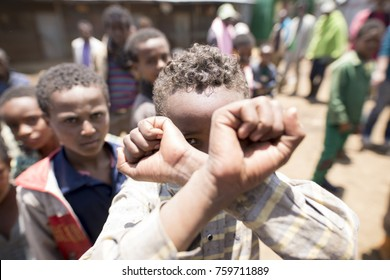 OROMIA, ETHIOPIA-SEPTEMBER 13, 2017: An unidentified boy hold up has arms in the sign for Oromo freedom in Ethiopia.