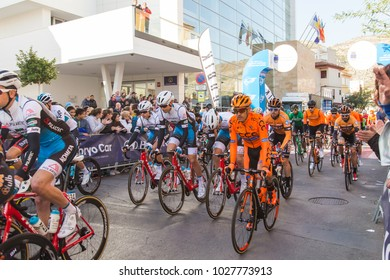 OROPESA DEL MAR, SPAIN - JANUARY 31, 2018: Bicyclists participate in the start bicycle race in La Vuelta on January 31, 2018 in Oropesa Del Mar, Spain
