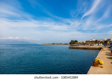 Oropos ferry docks in Attica, Greece, with calm waters of the sea against a cloudy sky
