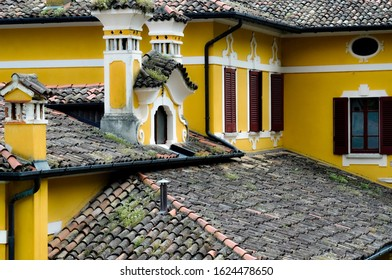 Orphanage in Prabione, Italy - Roof with yellow walls and grass