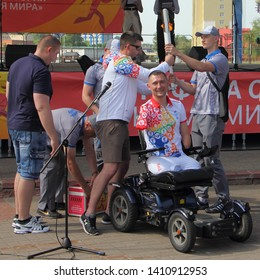 Orsha / Belarus – 05 29 2019: Torchbearer athlete Paralympic Alexey Talay with symbolic fire of 2nd European Games 2019