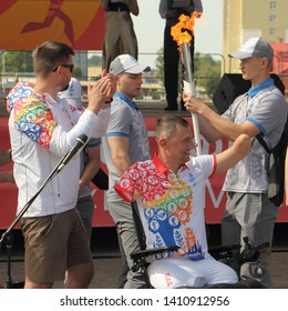 Orsha / Belarus – 05 29 2019: Torchbearer athlete Paralympic Alexey Talay with symbolic flame of 2nd European Games 2019