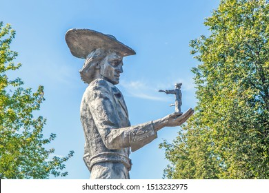 "ORSHA, BELARUS - AUGUST 12, 2019: Photo of Sculpture ""Gulliver with a midget in the palm of his hand."" Children's Park ""Fairytale Country""."