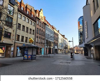 Ort, Land - January 01, 2020: Pedestrian zone 'Breite Gasse / Ludwigsplatz' in Nuremberg, Germany. Clothing store Wormland in front and other shops. It is a famous shopping street.