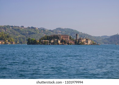 Orta Lake landscape. Orta San Giulio village, island Isola S.Giulio and Alps mountains view, Piedmont, Italy, Europe