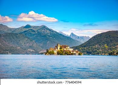 Orta Lake landscape. Orta San Giulio village, island Isola S.Giulio and Alps mountains view, Piedmont, Italy, Europe.