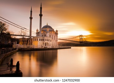 Ortakoy Istanbul cityscape at beautiful sunrise with amazing golden clouds Ortakoy Mosque and Bosphorus Bridge, Istanbul Turkey at golden hours. one of the best touristic destination of Istanbul.
