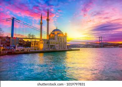 Ortakoy Istanbul landscape beautiful sunrise with clouds Ortakoy Mosque and Bosphorus Bridge, Istanbul Turkey. Best touristic destination of Istanbul.