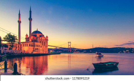 Ortakoy Istanbul panoramic landscape beautiful sunrise with clouds Ortakoy Mosque and Bosphorus Bridge, Istanbul Turkey. Best touristic destination of Istanbul. Romantic view of Istanbul city.