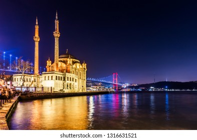 Ortakoy Mosque and Bosphorus Bridge (15th July Martyrs Bridge) night view. Istanbul, Turkey.